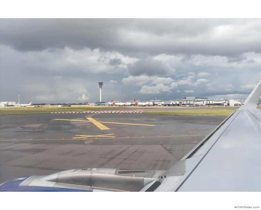 Now to play the taxiing game. First we go past Terminal 3 and the control tower...