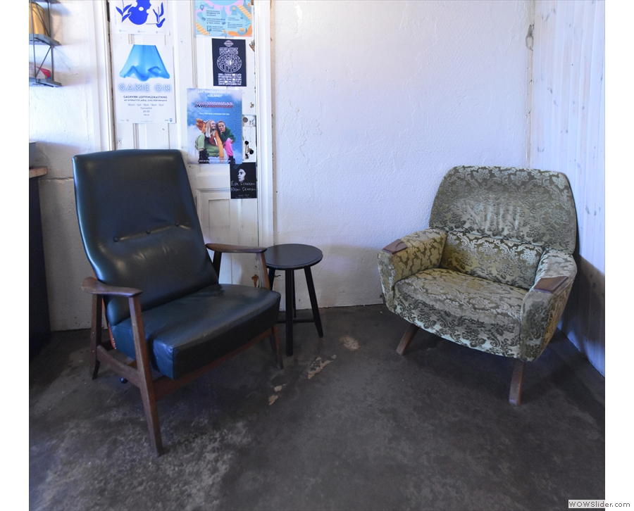 There's a pair of chairs (with a very small coffee table) down here on the left.