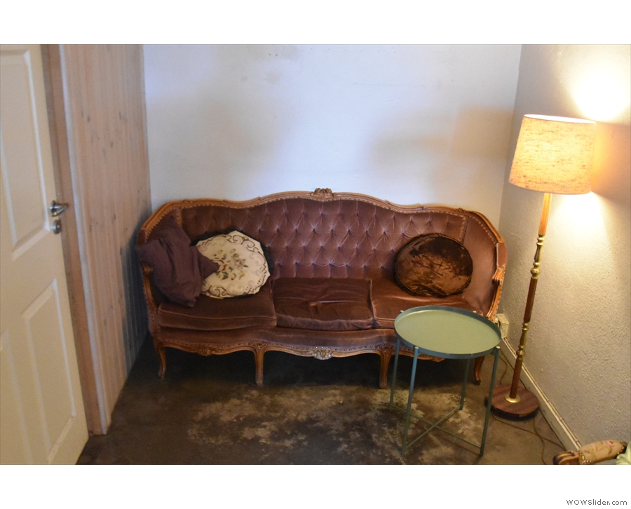 Finally, there's this sofa right at the back (although it is right by the toilet door).