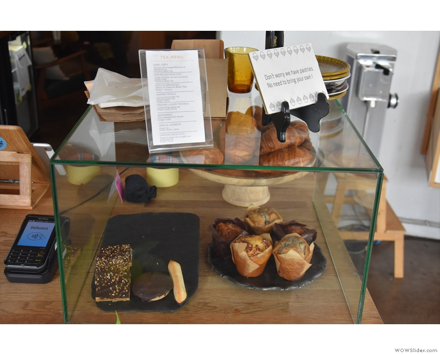 ... where you'll find the cakes and pastries in a display case on the end of the counter.