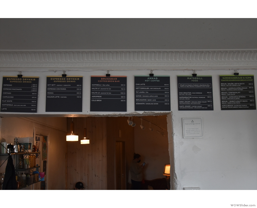 The food and drink menus are on the wall behind/above the counter...