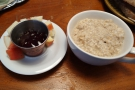My porridge in detail, this time served in a large cup, along with some diced apple.