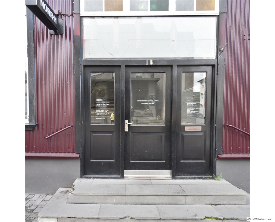 The way in is via these doors in the middle of the building, shared by all its tenants.