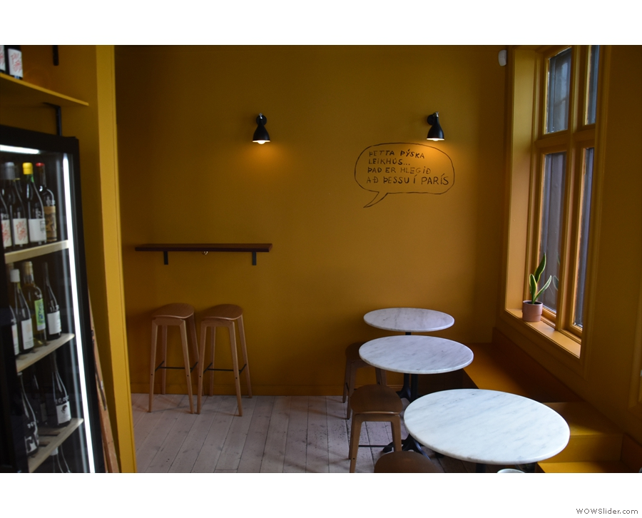 There's more seating towards the back, including another two-person bar and...