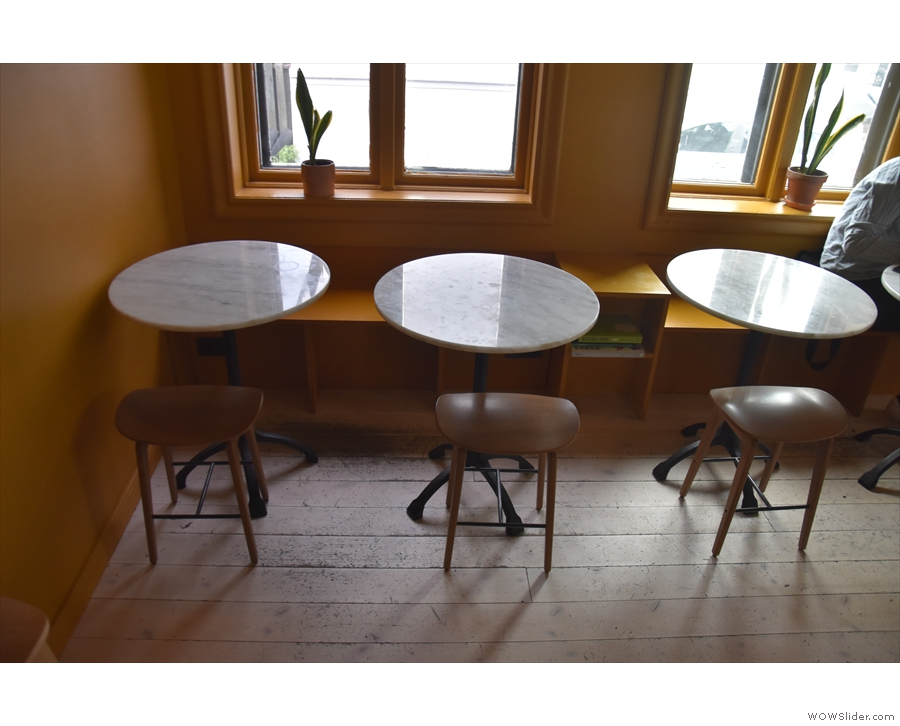 ... four more low, round tables, two for each window. Mikki Refur continues...