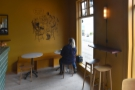 ... another two-person bar between the windows and a pair of low tables at the far end.