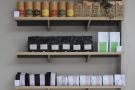 Rosslyn Coffee has a strong retail selection on the back wall to the right of the counter.