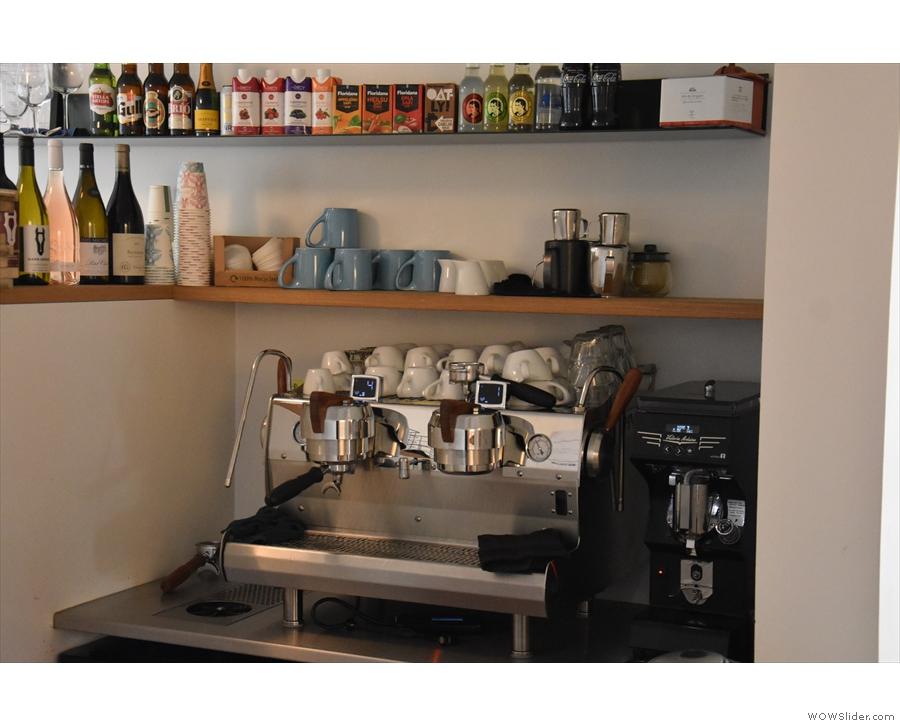 ... and the espresso machine off to the right. There's also a kitchen at the back.