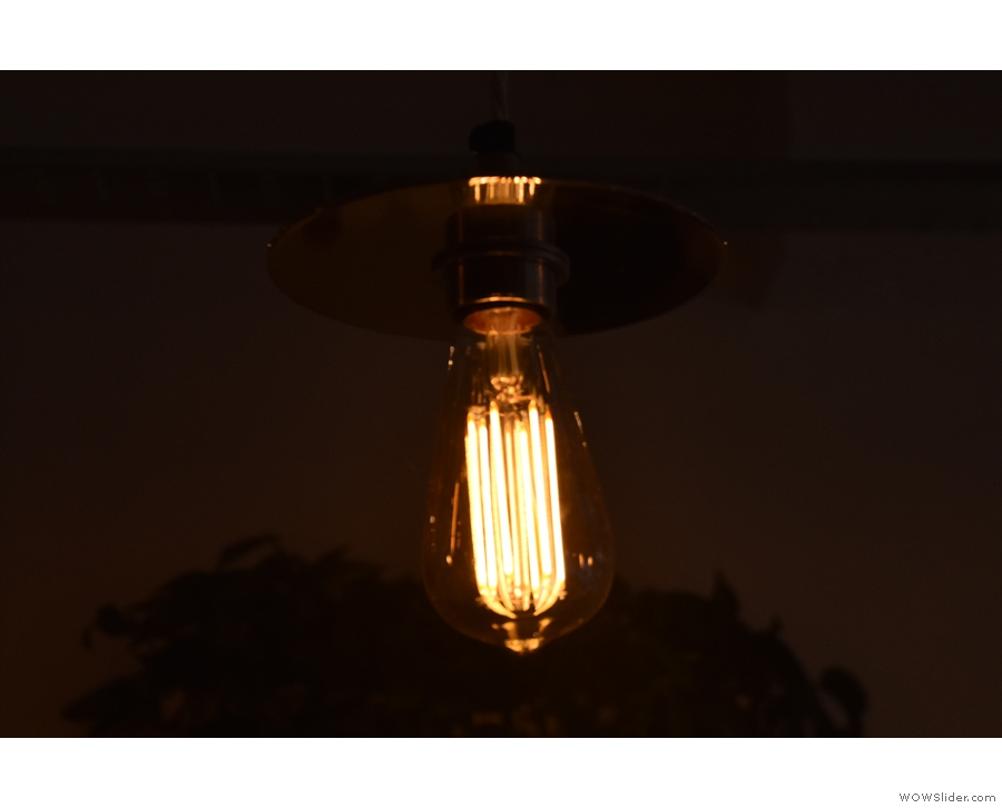 Meanwhile, the more traditional bare bulbs hang over the counter.