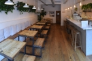 Inside, the layout is simple, counter on the right, seating on the left...