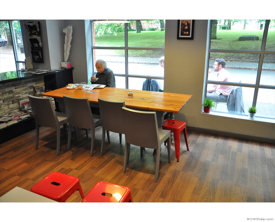 ... replacing this large, communal table that was there when I visited in August 2014.