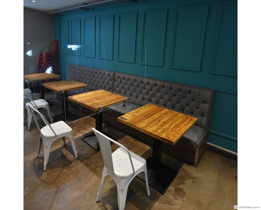 The remaining seating is against the left-hand wall. These tables (with Perspex screens)...