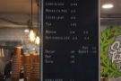 ... with the coffee menu on the pillar at the corner of the counter.