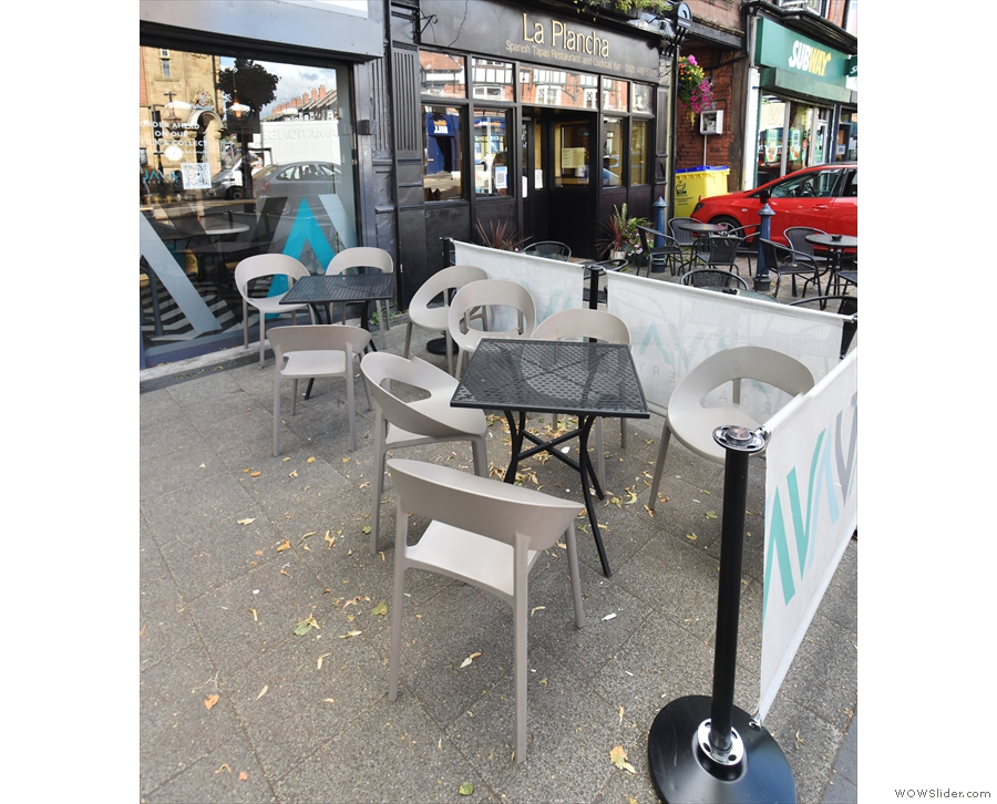 There's a generous outdoor seating area with two tables on the right...
