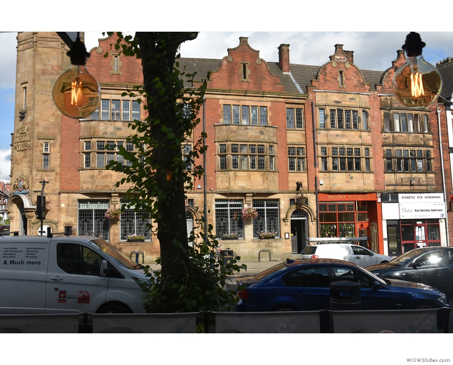 ... the window, where you get a view of the handsome buildings across the road.