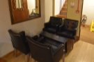 ... just to the right of the door, are these four armchairs and their narrow coffee table.