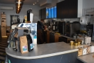To business. The short end of the counter faces you as you enter. You actually collect...