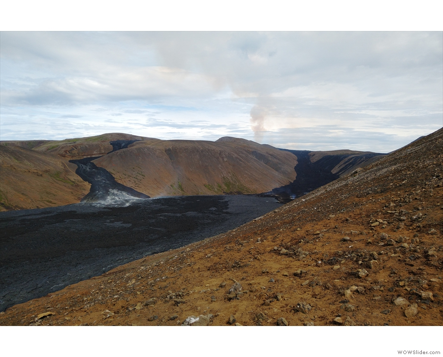 ... it was on up the side of the ridge. The plume of smoke marks the site of the volcano.