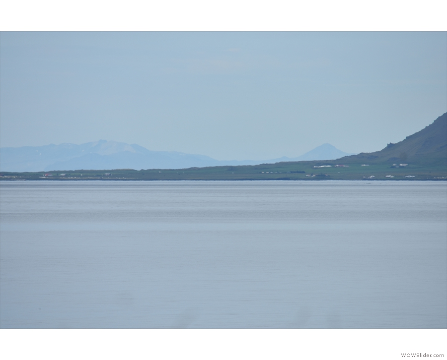 I think that is Akranes, with (if I'm right), the Snæfellsness peninsula in the far distance.