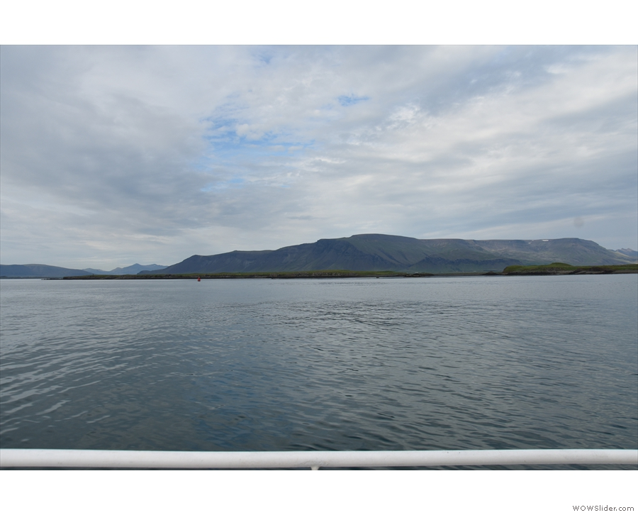 The view across the bay to the northern end of Viðey Island, Esjan in the background.