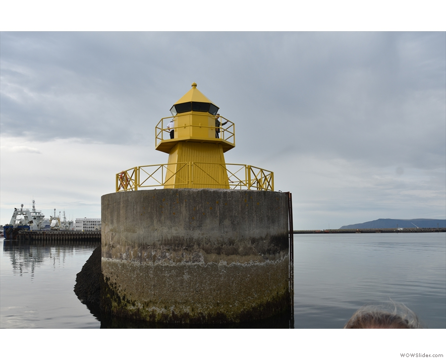 We slipped into the Old Harbour past one of the squat, yellow lighthouses...