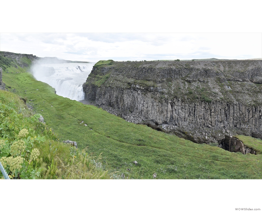 Here's a shot of Hvítá river disappearing into the canyon, with the falls in the background.