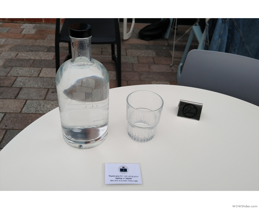 I also got a bottle of water and a glass (note the no laptops/tablets signs)...