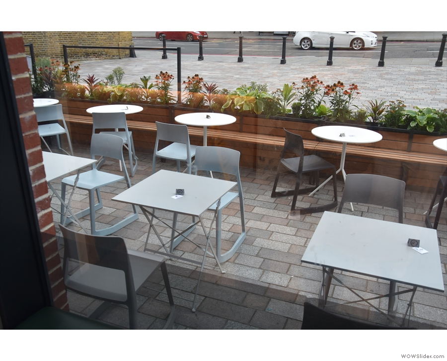 A view of the outside seating seen from inside.