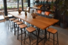 It leads to another room at the back on the left, with this communal table in the middle.