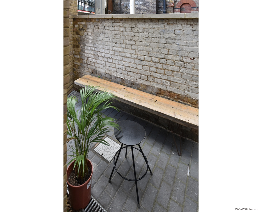 ... leads to a fourth bench in the narrow outside seating area.
