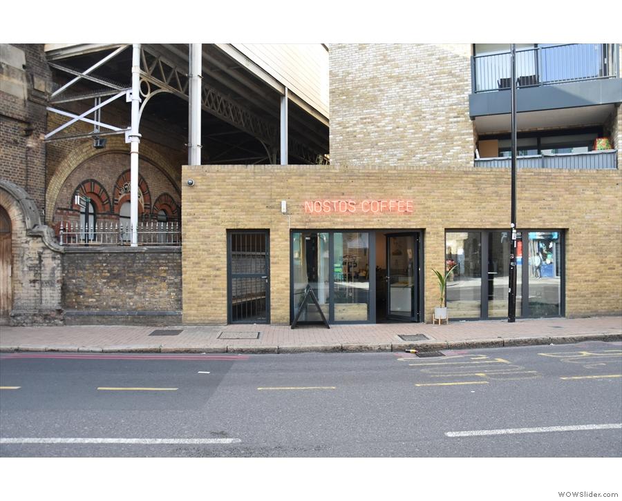 Nostos Coffee occupies this low-slung, single-storey brick building.