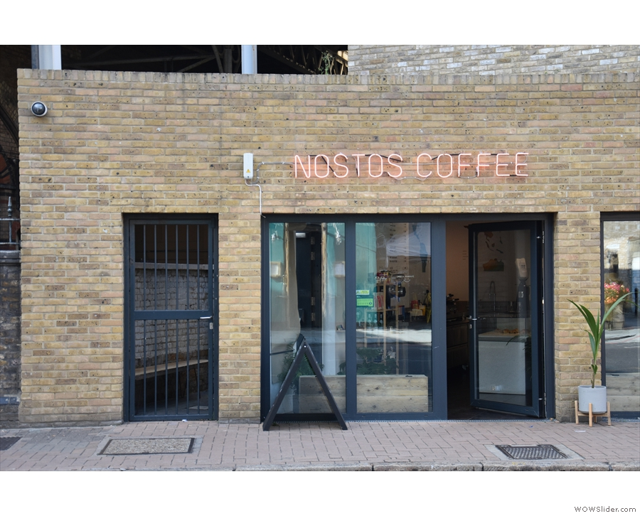 The entrance is under the 'coffee' on the right of the left-hand window. Don't be fooled...