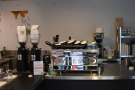 The Synesso espresso machine and its grinders are at the back of the counter.