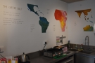Back inside, a map of the world's coffee-growing belt graces the walls.