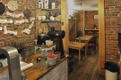 Beyond the end of the counter, an opening leads into a cosy back room.