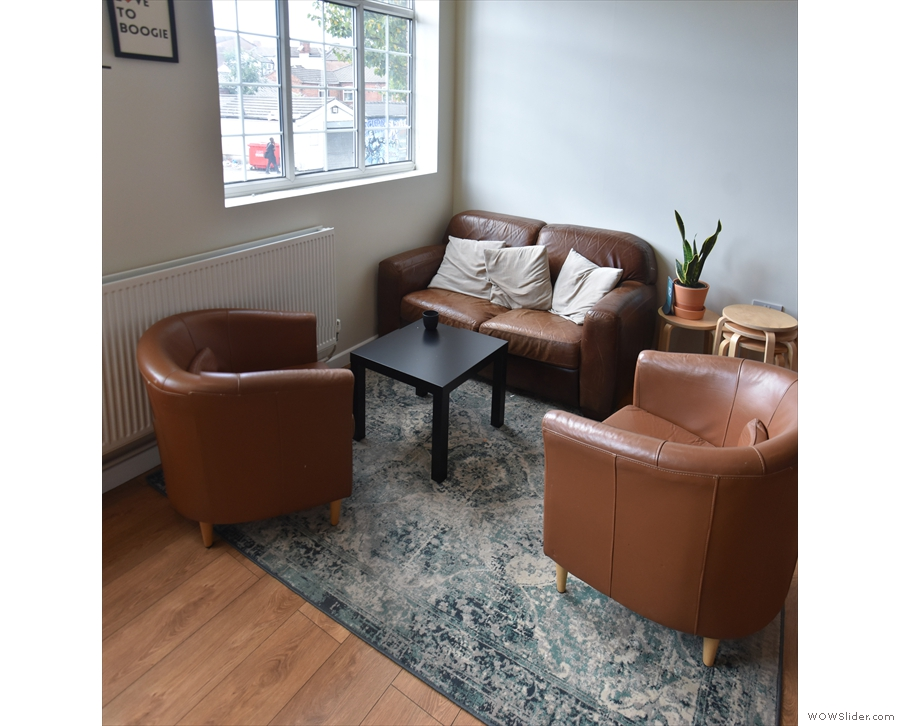 A second three-piece suite occupies the right-hand corner...