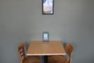 As you come in, there's a two-person table against the back wall.