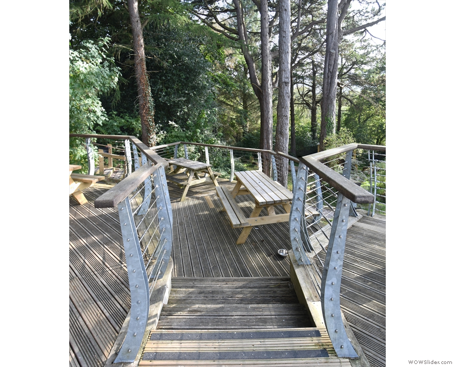 Towards the back, on the right, steps lead down to a smaller, lower teir of decking...