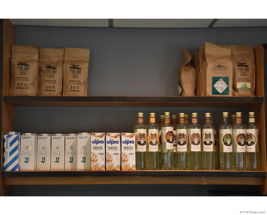 Meanwhile, bags of beans, plus non dairy alternatives, are on a shelf behind the counter.