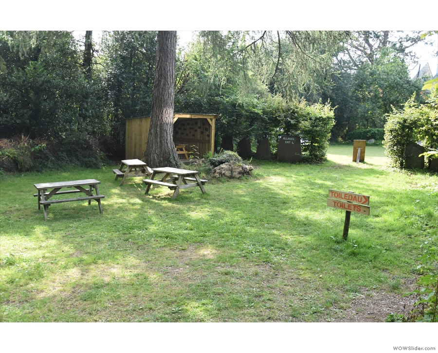 ... the grassy expanse, home to more picnic-style tables...