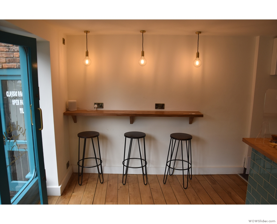 ... while to the left is this three-person bar against the left-hand wall.
