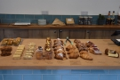 The day's baking is on the left: cakes, biscuits, pastries and some savouries are on display.