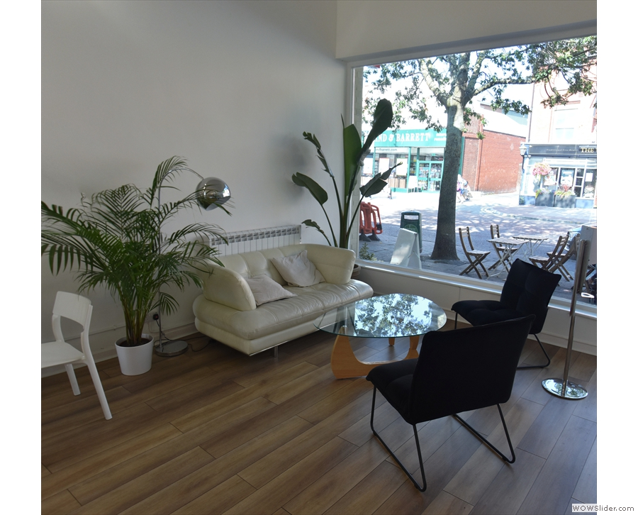 A better view of the coffee table and two armchairs that go with the sofa.