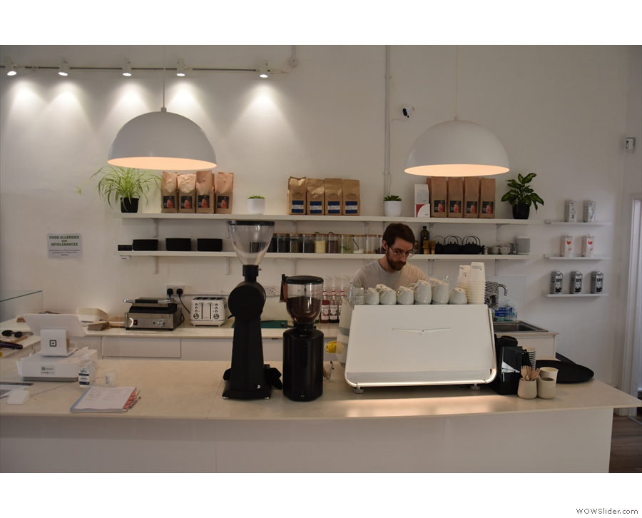 You order and pay at the counter (left) while the espresso machine is on the right.