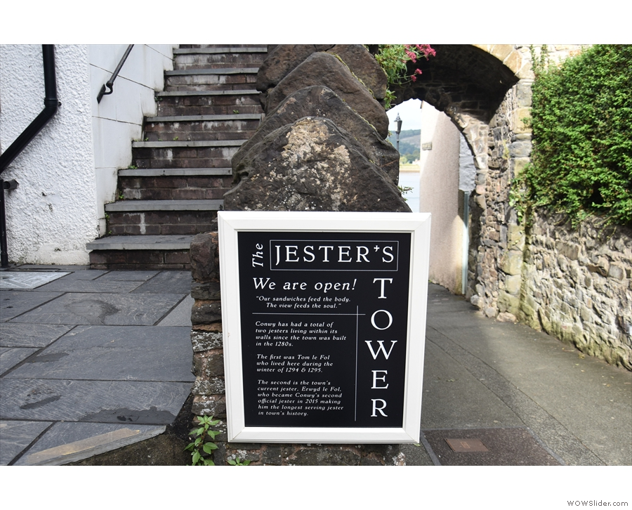 The tower is known as The Jester's Tower and the coffee shop is run by the town jester.