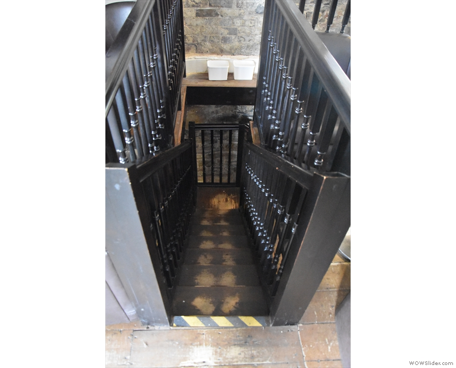 ... a narrow flight of stairs leading down...