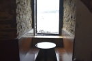 The wooden benches down the side are modern, but this style of window-seating would...