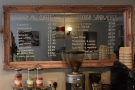 ... while the coffee and sandwich menus are written up on a mirror on the left-hand wall.