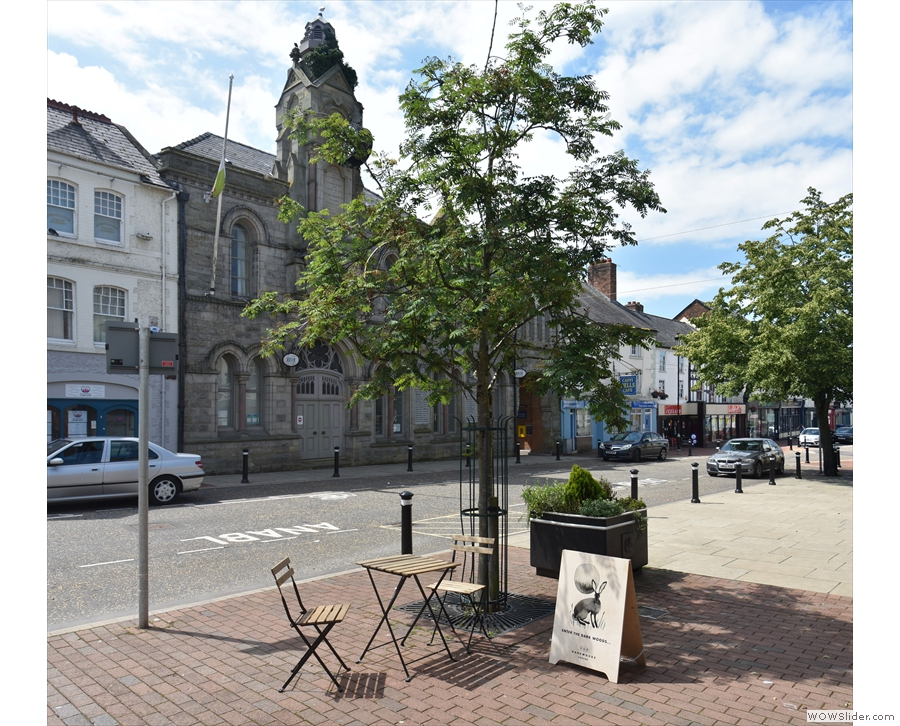 ... each window and the third by the tree, the Town Hall behind (from June this year).