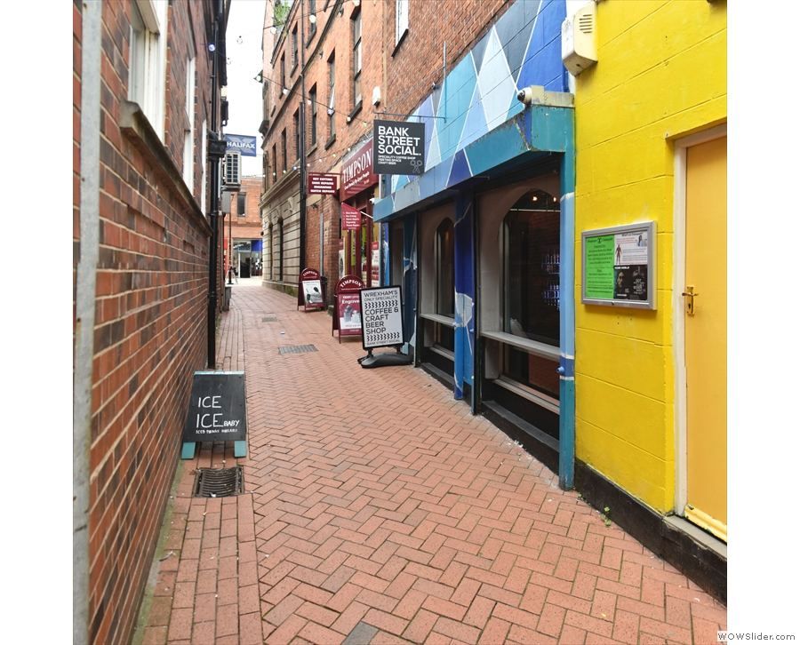 At the upper end of the narrow Bank Street, in the pedestrianisEd centre of Wrexham...